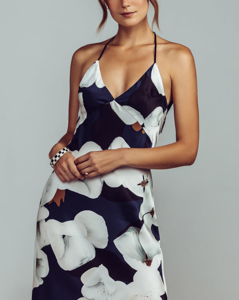 Camo Bloom Bias Slip dress is crafted from a silk printed with an oversized magnolia floral in shades of black, navy, white, and bronze