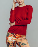 Superfine knit cashmere sweater from Zynni in a burnt sienna red
