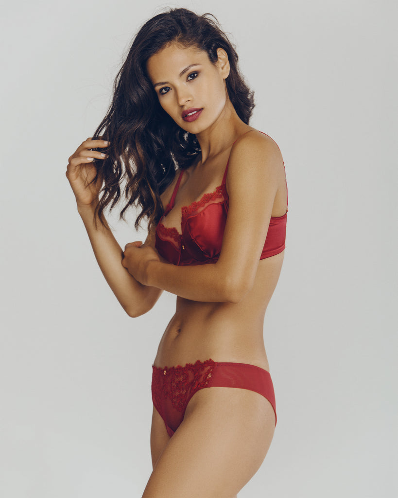 Matching brazilian bikini by Ritratti is sleek and easy to wear, with floral embroidery at the front and a sheer rear