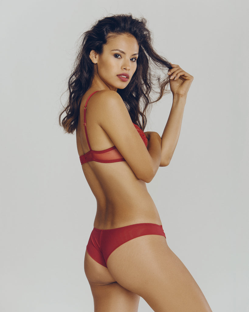 Embroidered red lingerie set from Ritratti, with a plunge bra and matching brief