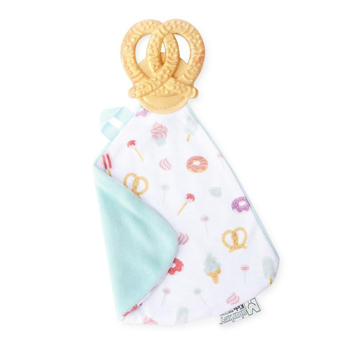 sweet and salty Munch-It Blanket- a convenient teether and cozy blanket for baby. Designed to target baby's emerging front& eye teeth as well as early molars.  The soft blanket is perfect for snuggling and absorbing drool