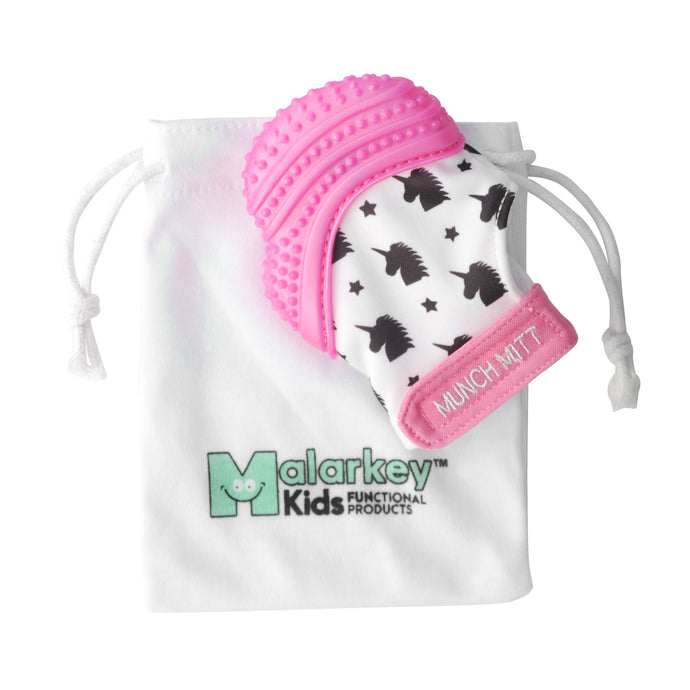 pink unicorn MUNCH MITT THE ORIGINAL MOM INVENTED HAND HELD TEETHER.  100% FOOD-GRADE SILICONE. HELPS BABY WITH SELF SOOTHING