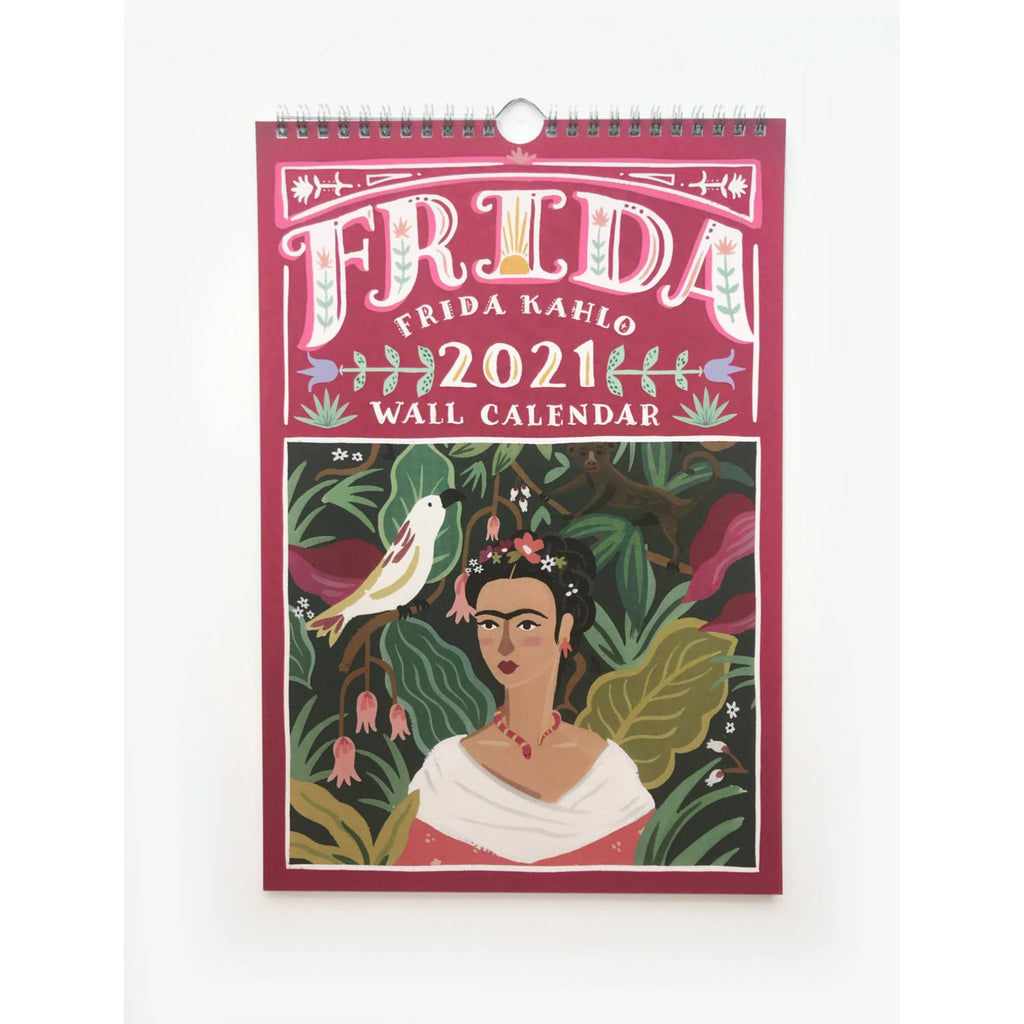 2021 wall calendar with spiral top and colorful illustration of frida kahlo surrounded by flowers and foliage and a bird