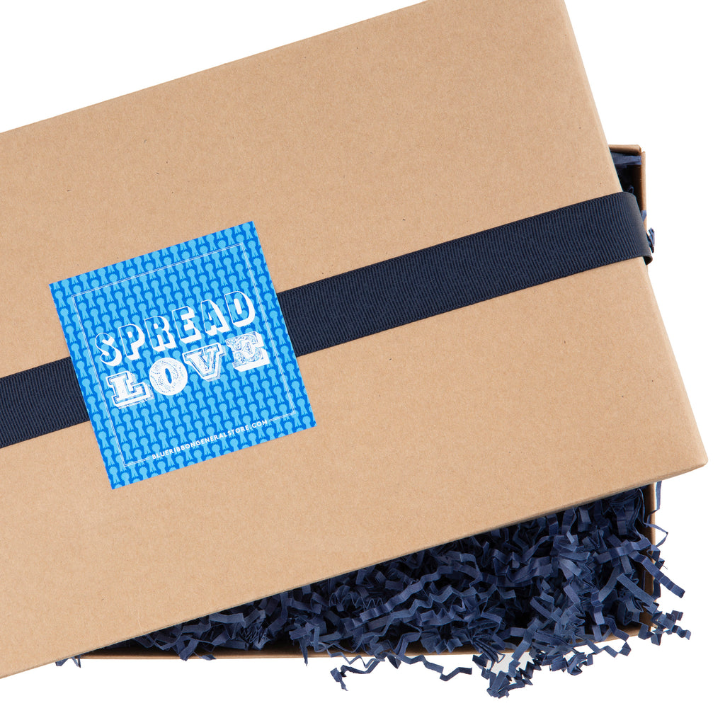 kraft gift box with dark blue crinkle paper ribbon and spread love sticker