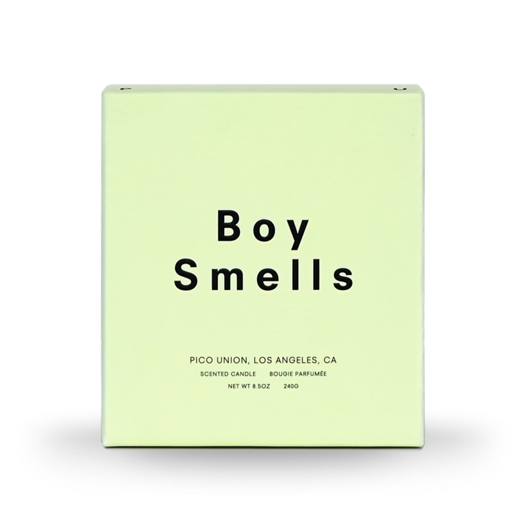 boy smells ambrosia candle