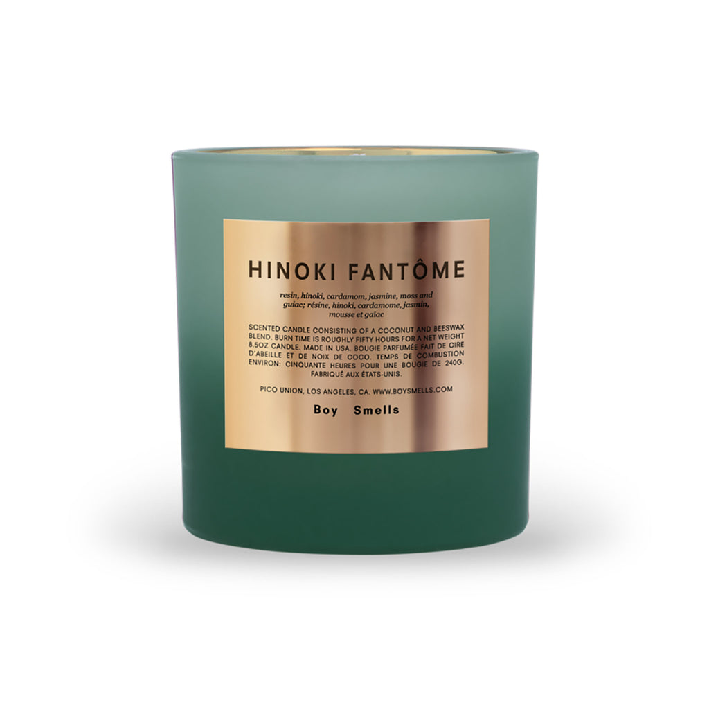 green matte glass candle with gold label reading hinoki fantome