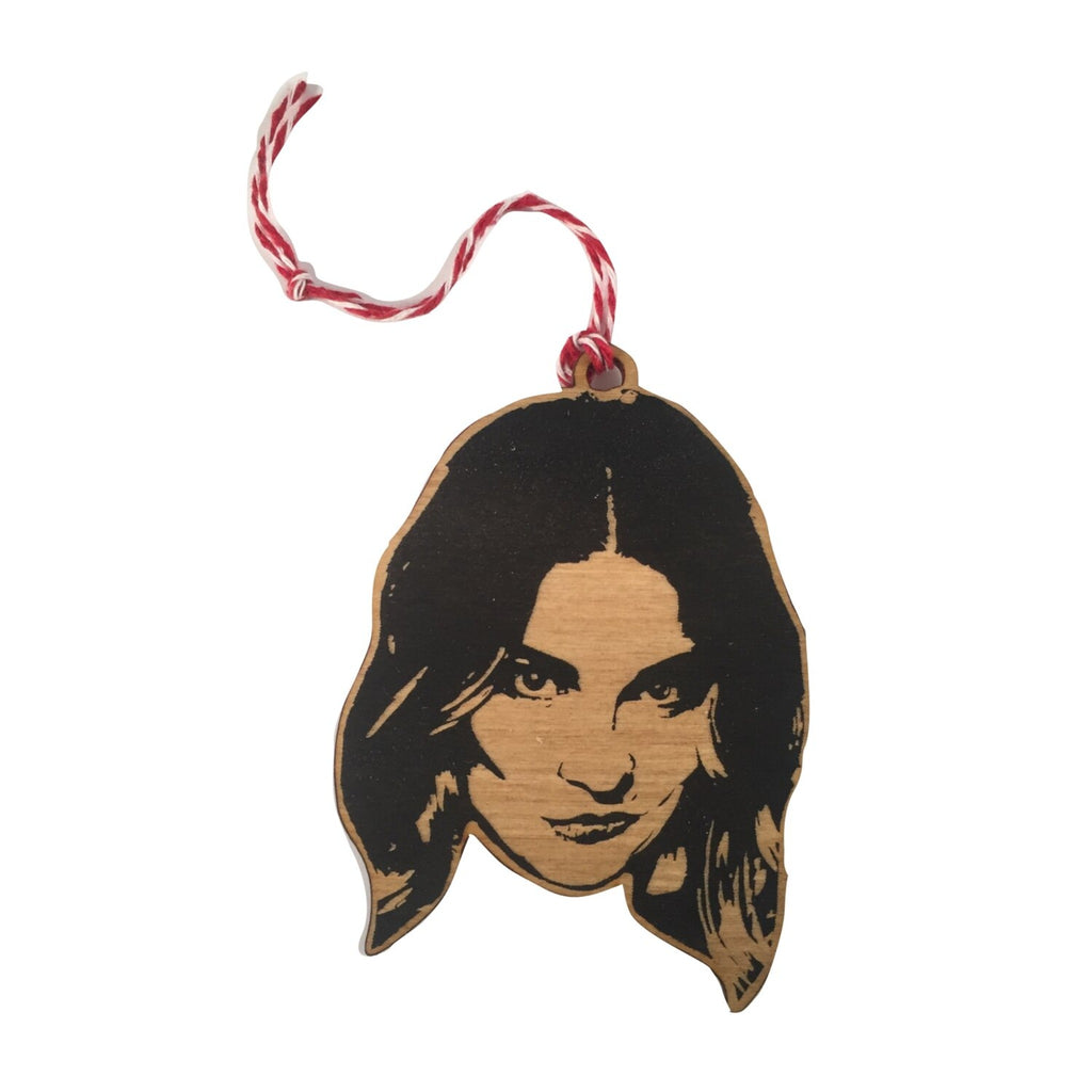 wood ornament of the head of annie murphy as alexis rose with red and white twine hanger