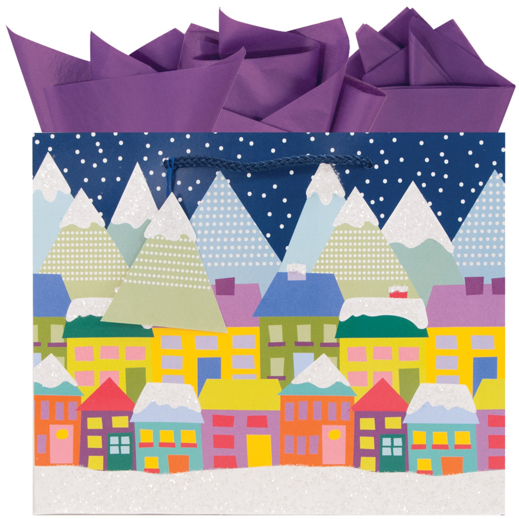 medium gift bag with a colorful village scene with mountains