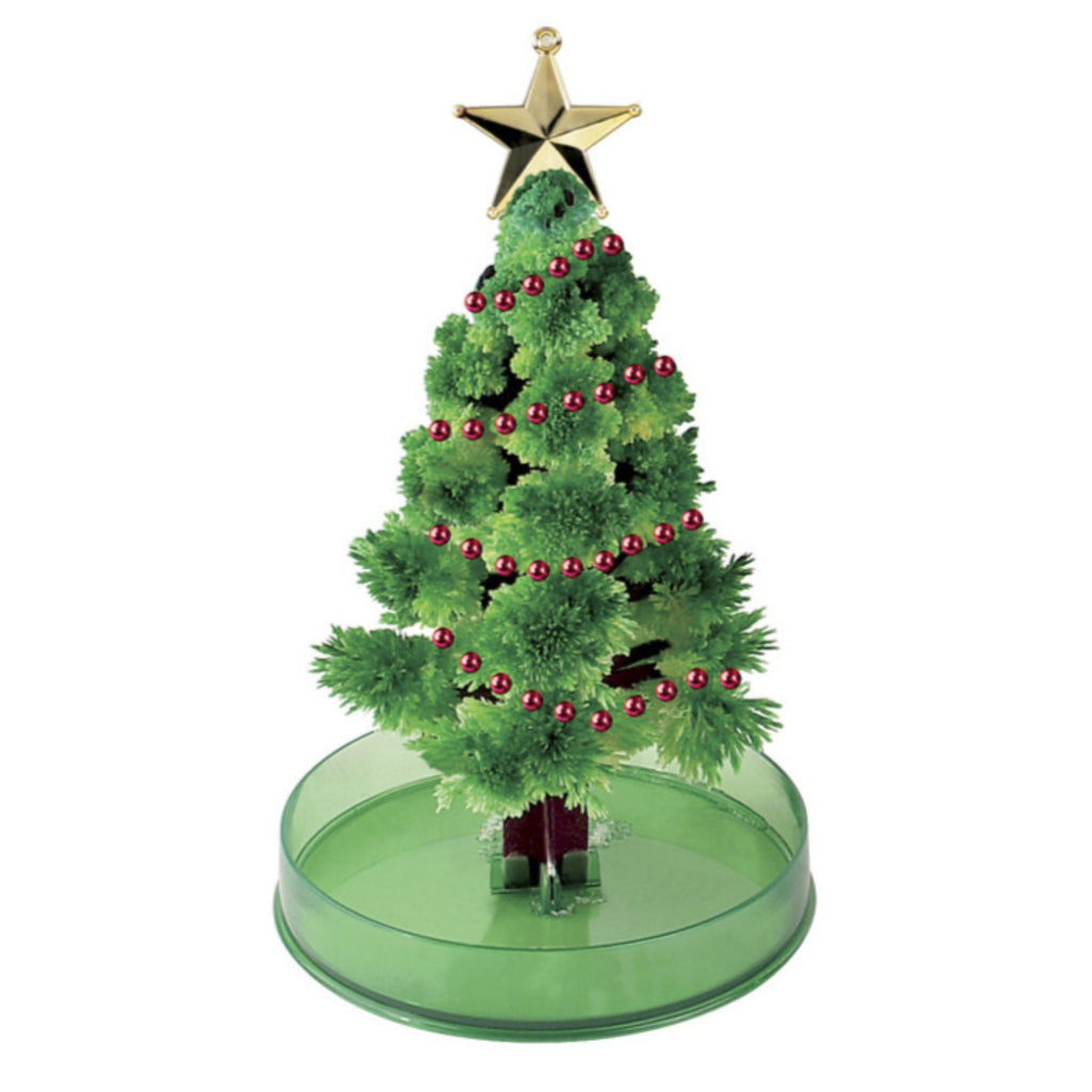 growing crystal christmas tree with green branches, gold star, and red beaded garland