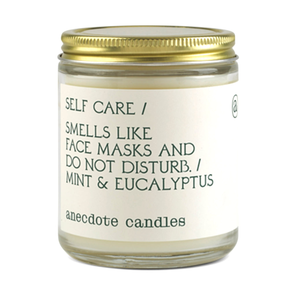 anecdote self care scented coconut soy wax candle in glass jar with gold lid