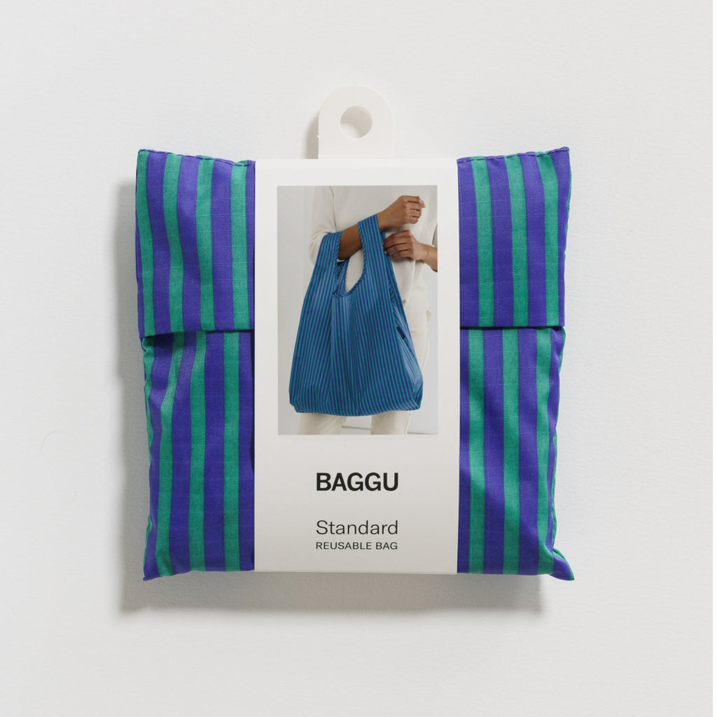folded reusable grocery tote in cobalt blue and jade green stripes