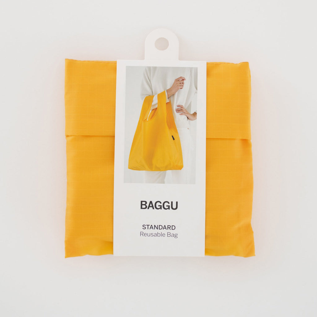 baggu reusable standard ripstop nylon bag in yolk yellow with packaging