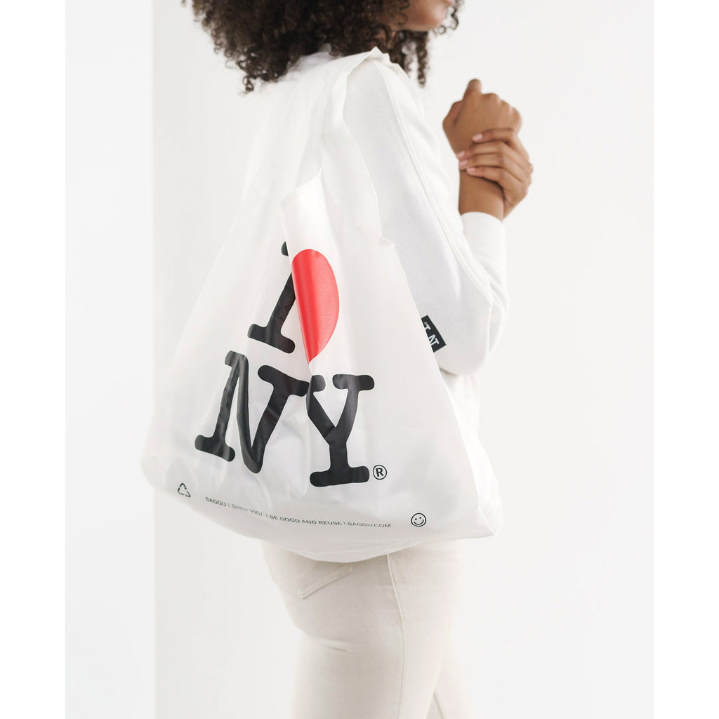 baggu standard ripstop nylon reusable shopping bag i love new york on shoulder