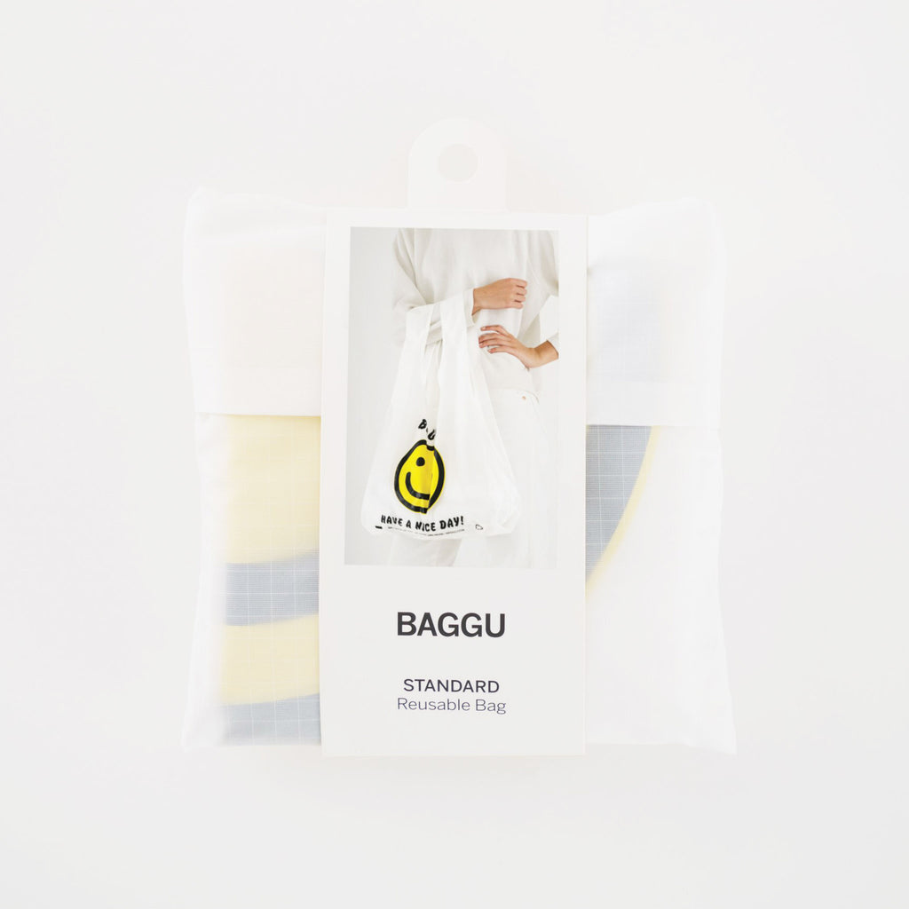 baggu reusable standard white ripstop nylon bag in thank you happy with yellow smiley face and have a nice day in black text with packaging