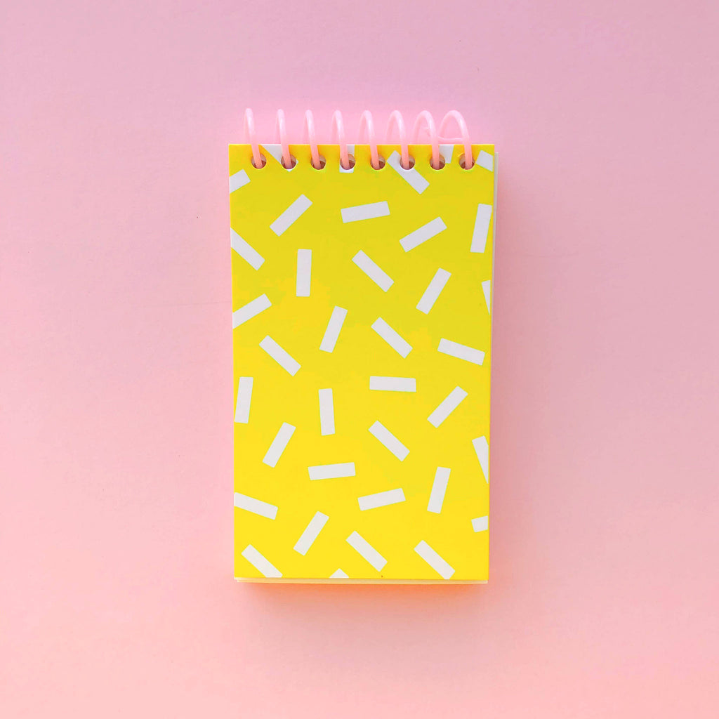 bash party goods sprinkle notepad on pink background