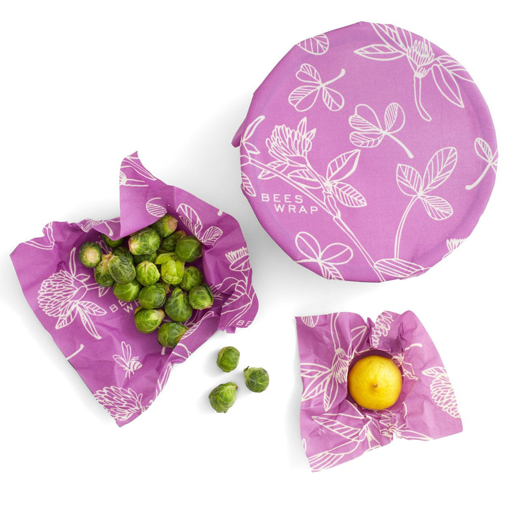 bee's wrap eco-friendly food storage three pack of assorted sizes in purple clover print with food