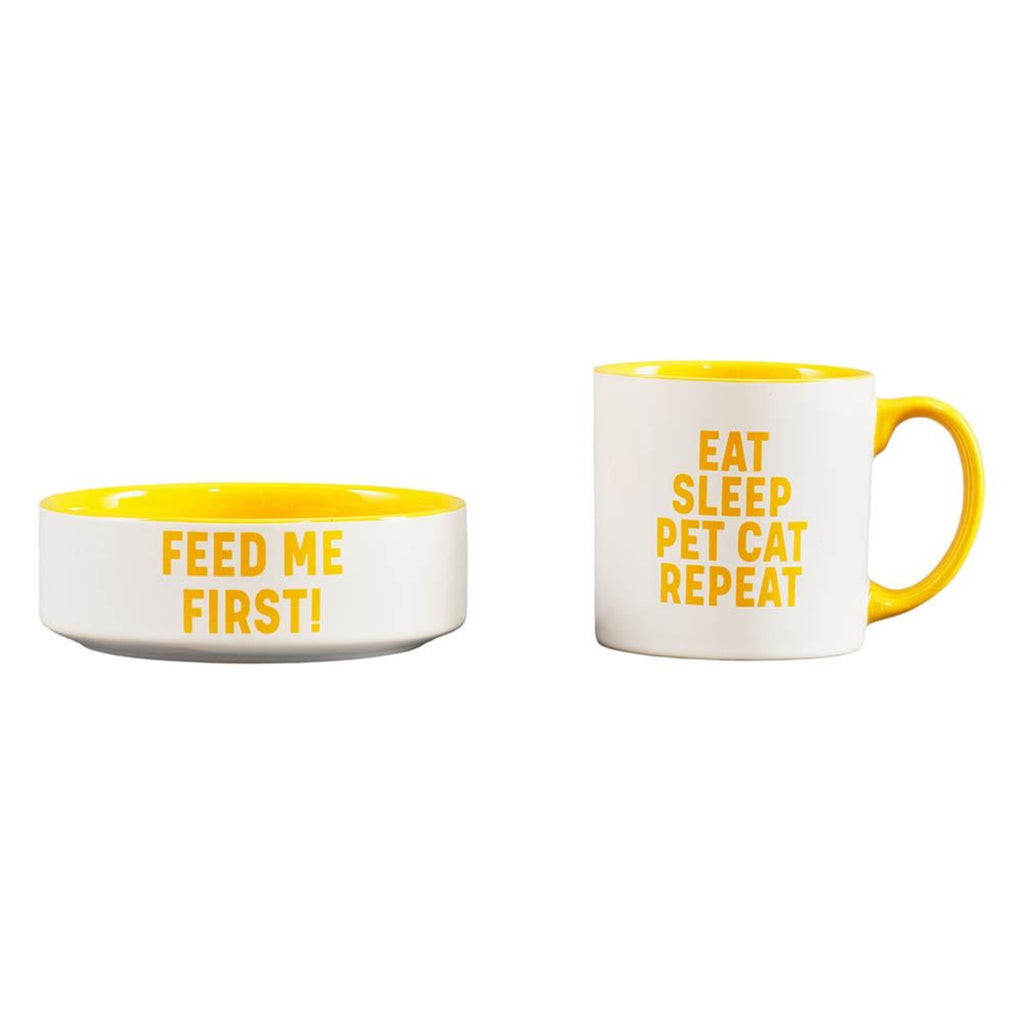 "white cat bowl with yellow interior and the words ""feed me first"" and matching mug with the words ""eat, sleep, pet cat, repeat"""