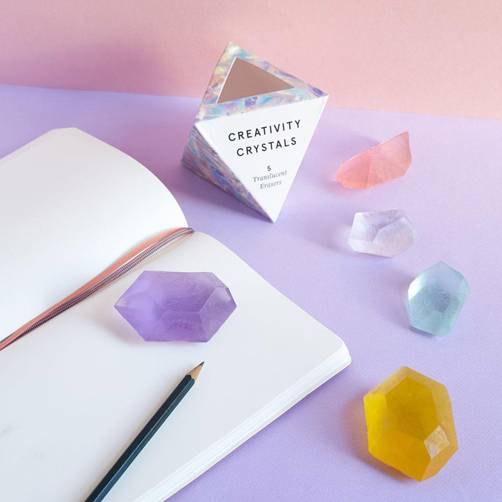 chronicle creativity crystals translucent pencil erasers set of 5 on background with notebook and pencil