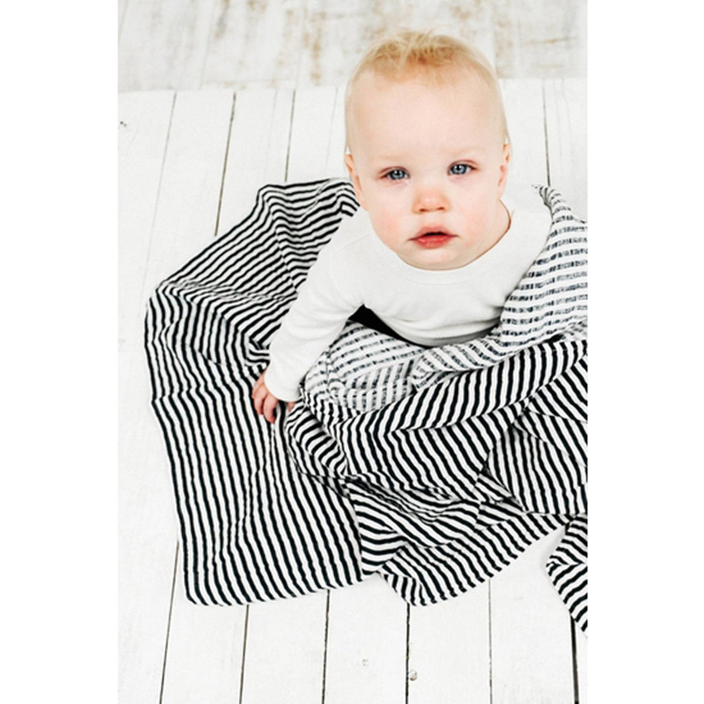 clementine kids single cotton muslin baby swaddle blanket in black and white striped pattern with toddler