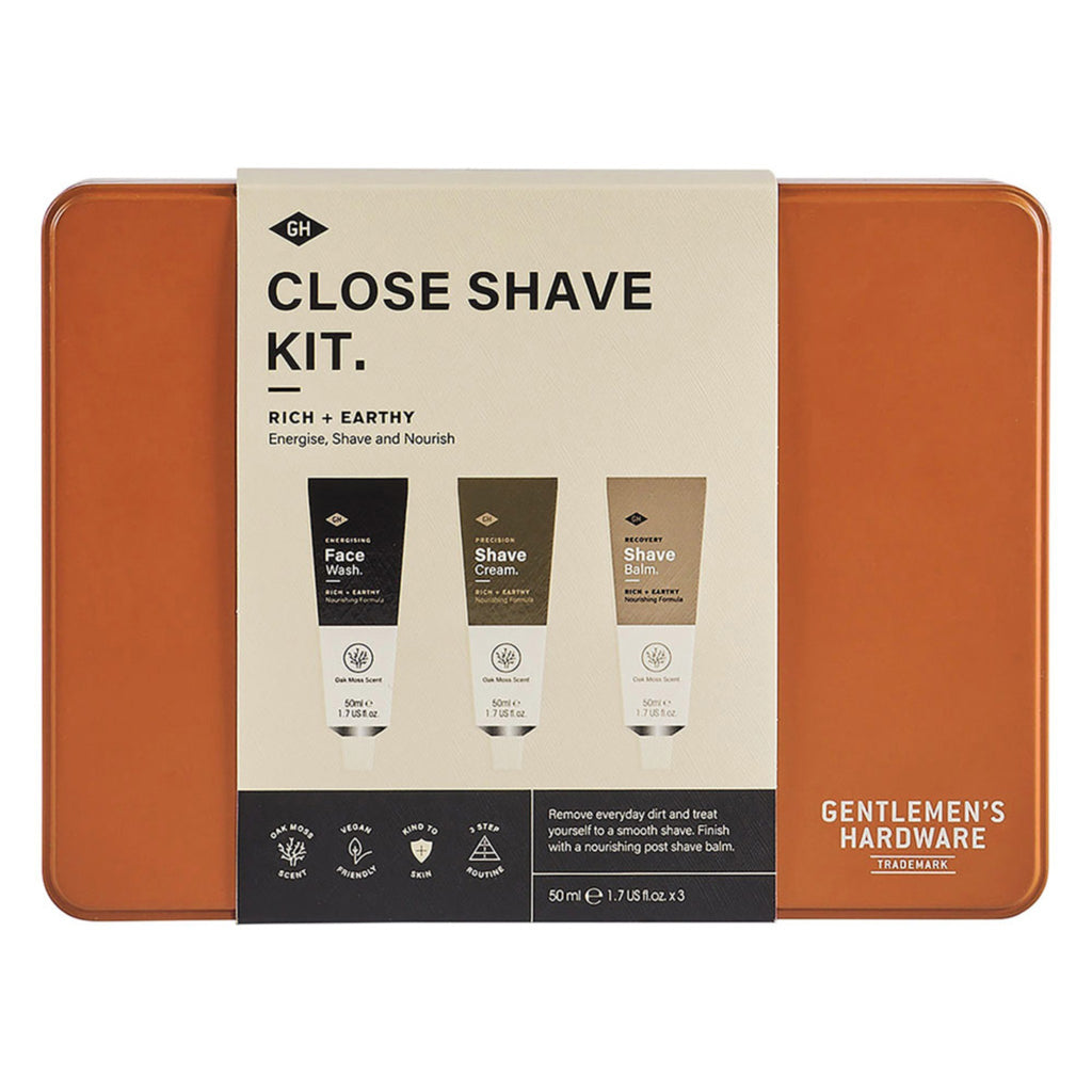 "rectangular orange tin with beige belly band reading ""close shave kit"""