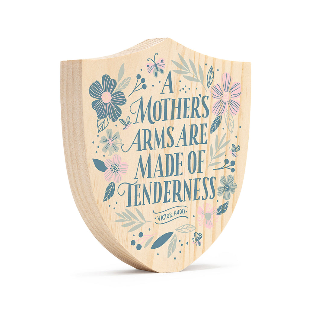 compendium a mother's arms are made of tenderness screen-printed on natural wood crest hanging wall decoration front