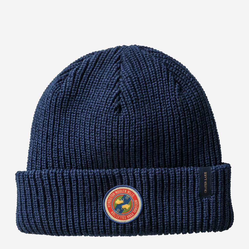 solid navy knit beanie hat with red, blue, yellow, and green pendleton woolen mills patch