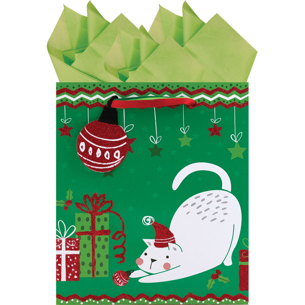 small green gift bag with white cat playing with ornaments and surrounded by presents