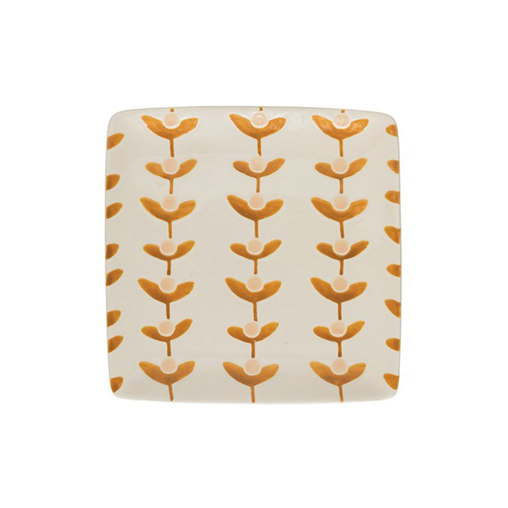 creative co-op square hand-painted stoneware plate with repeating floral pattern in light dusty pink and dark golden yellow