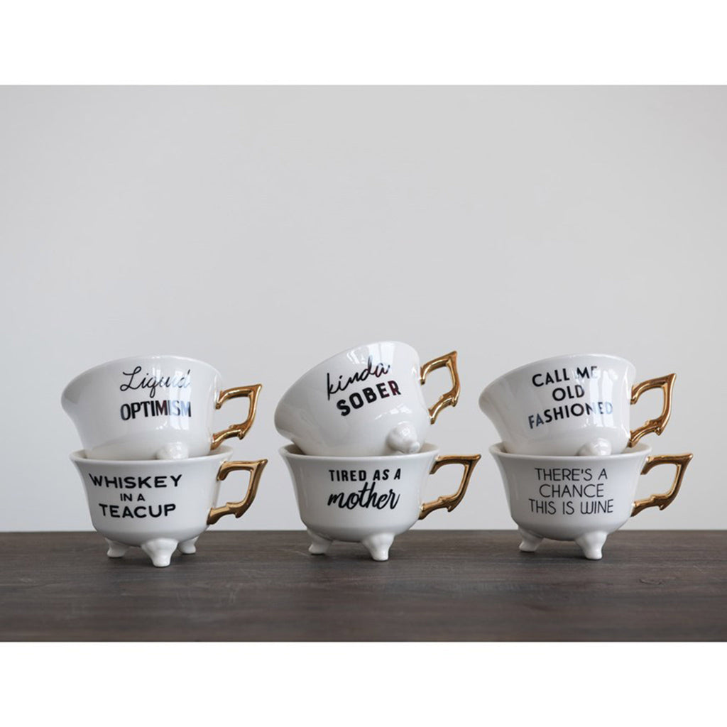creative co-op 6 ounce white stoneware footed teacups with assorted sayings stacked
