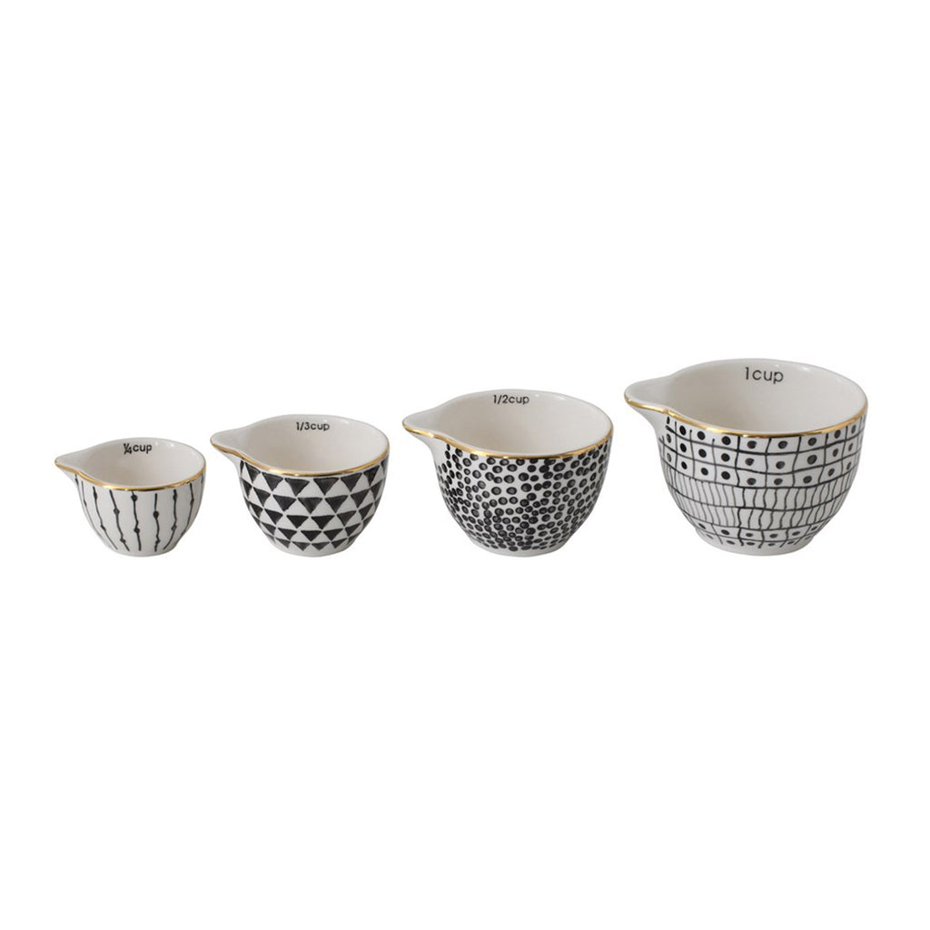 creative coop white stoneware set of four stacking measuring cups with black patterns and gold electroplating shown individually