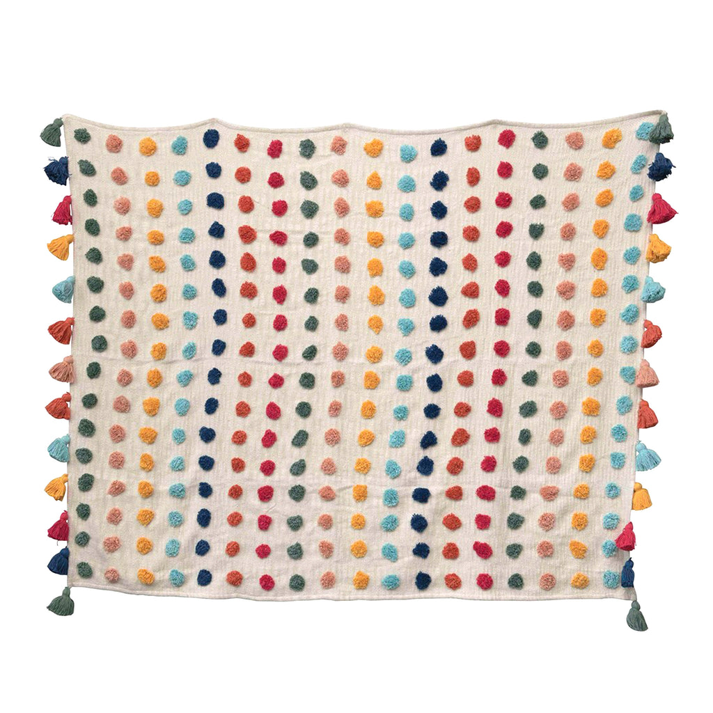 creative co-op woven cotton throw blanket with multicolored tufted dots and tassels lying flat