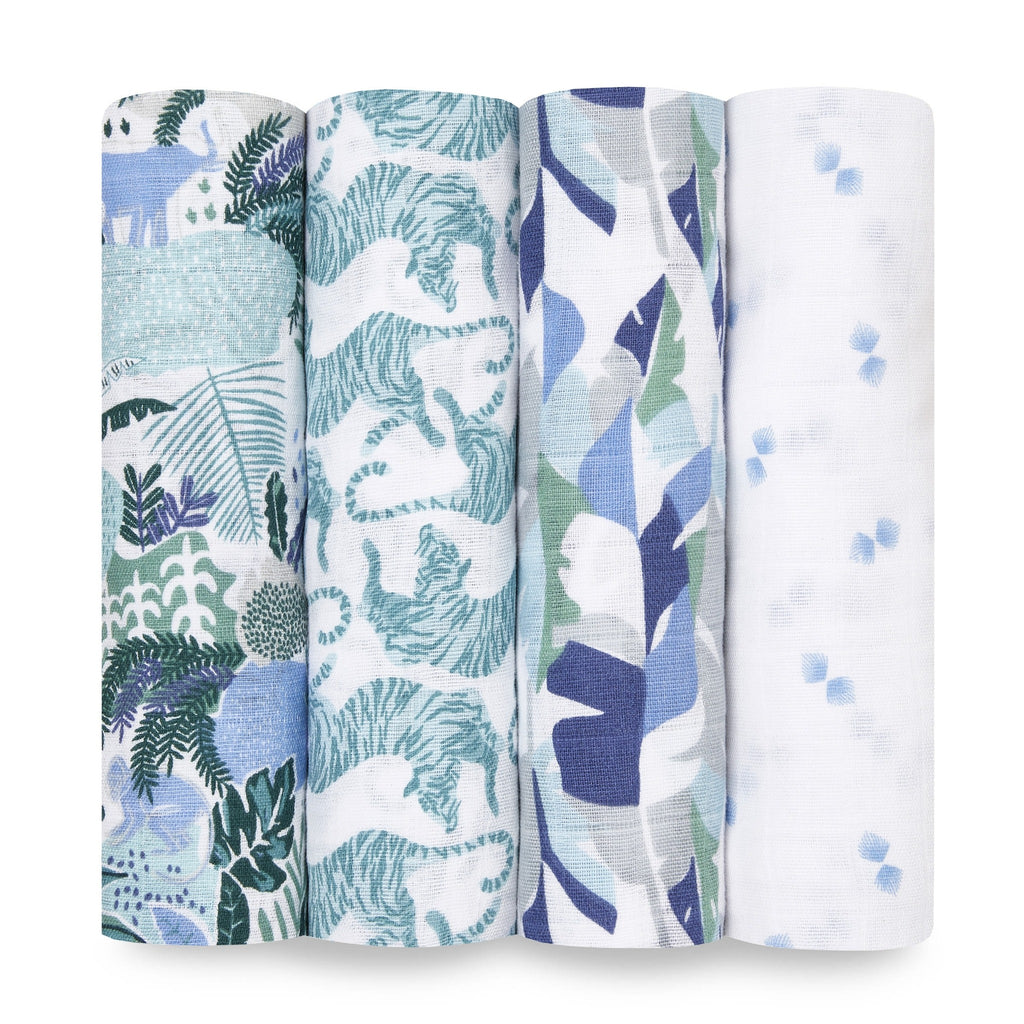 dancing tiger swaddle set in assorted blue and green patterns: jungle foliage, tigers, leaves, and blue and white geometric pattern