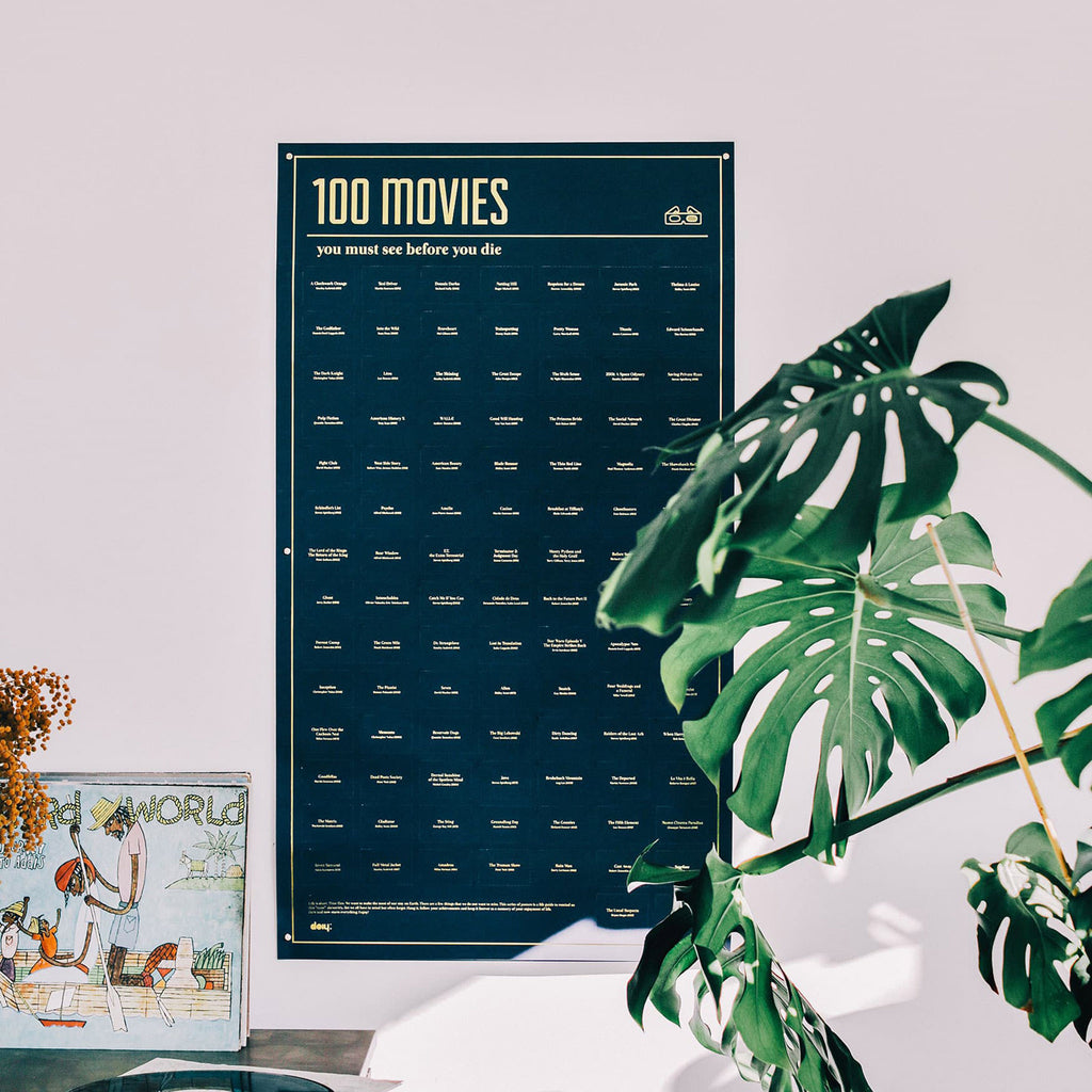 doiy design 100 movies you must see before you die interactive poster hanging in room setting