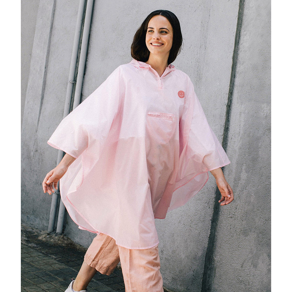 doiy design smile in the rain pink adult rain poncho on model