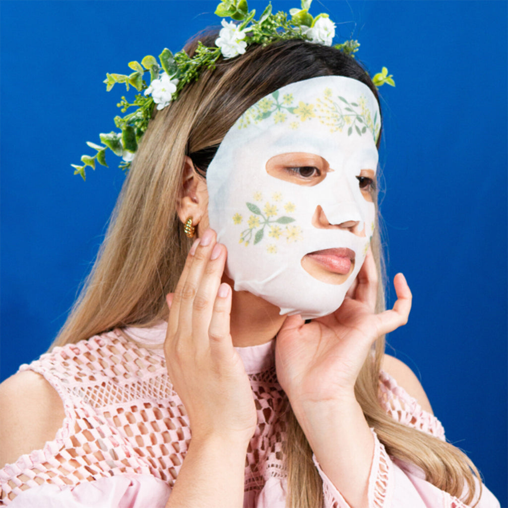 facetory dream garden elderflower rejuvenating and illuminating sheet face mask on model