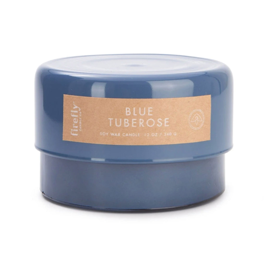 firefly candle company botany blue tuberose 12 ounce scented soy wax candle in blue glass canister with lid on