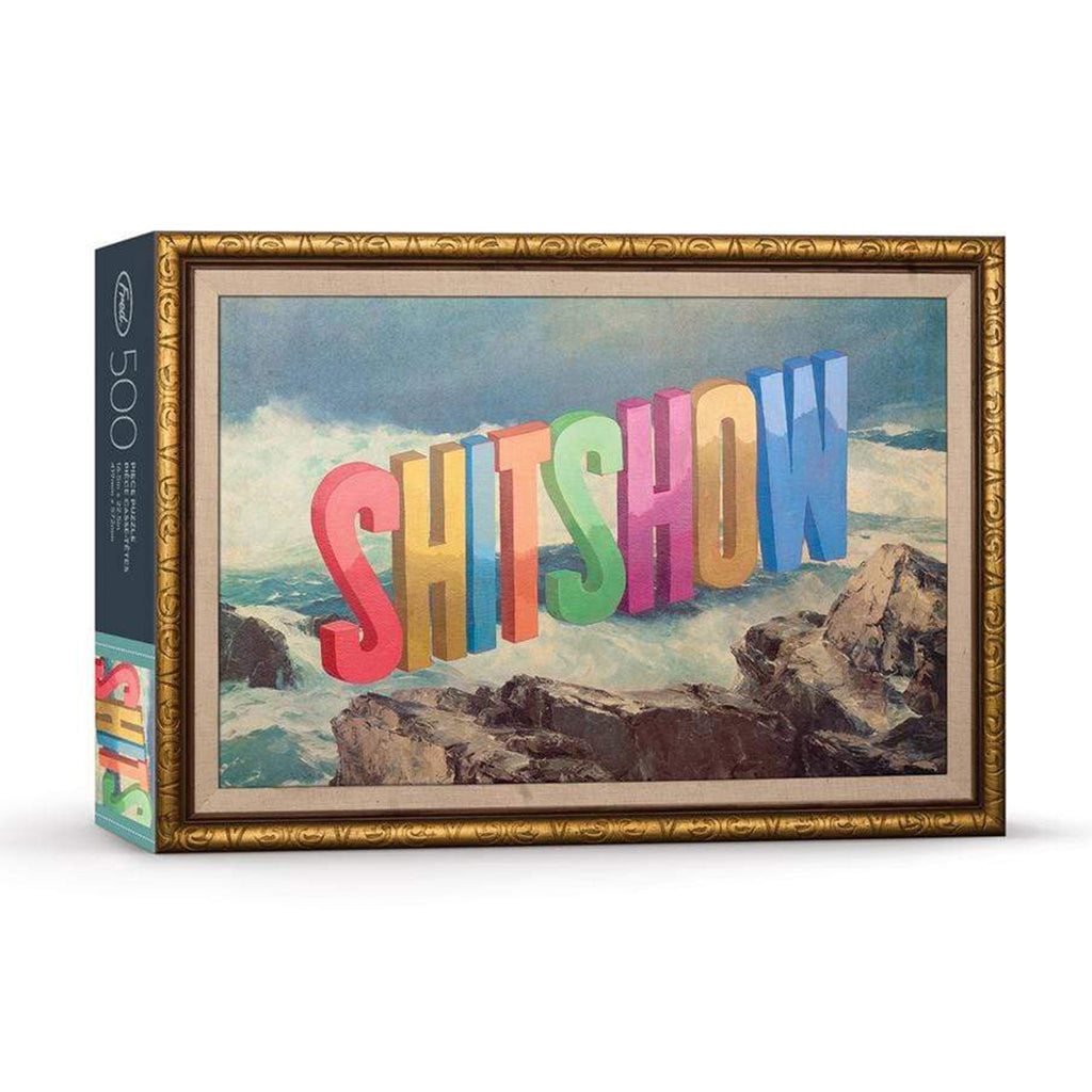 genuine fred 500 piece shit show adult jigsaw puzzle with artwork by wayne white packaging front on angle
