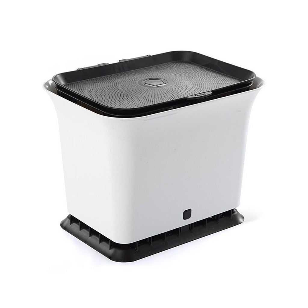 full circle fresh air black and white kitchen countertop compost collector on angle