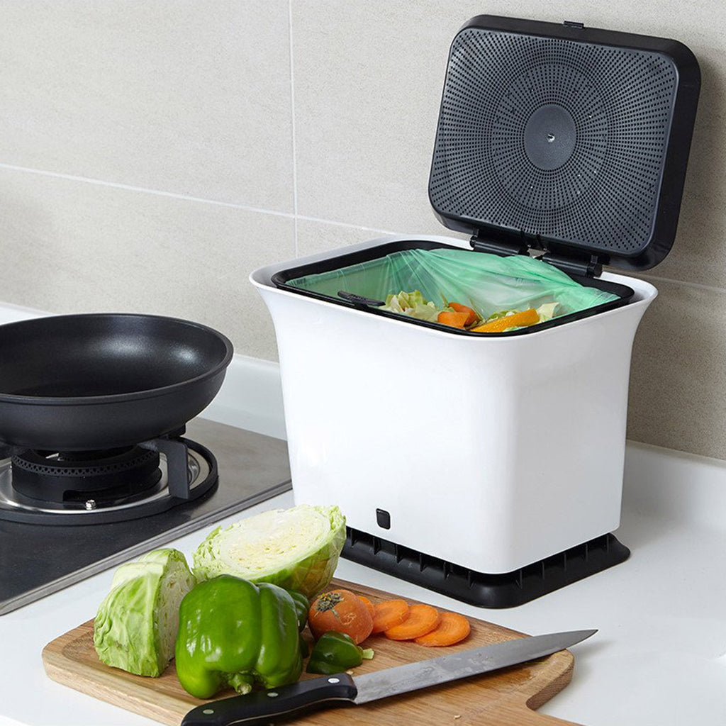full circle fresh air black and white kitchen countertop compost collector in use