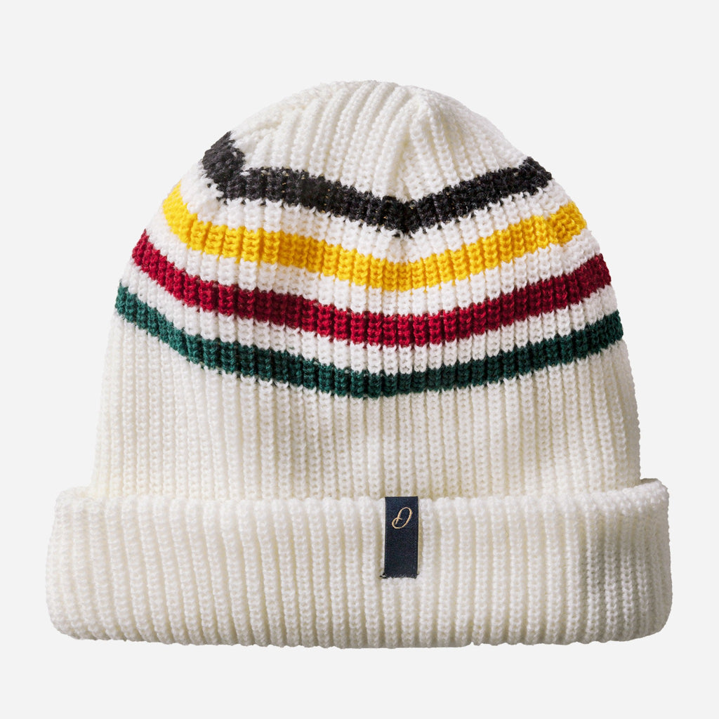 white knit beanie hat with black, yellow, red, and green stripes