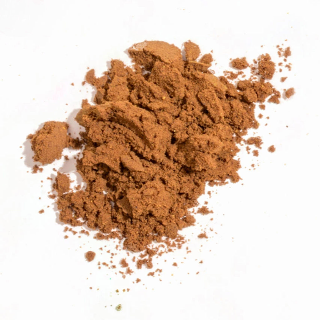 golde cacao turmeric superfood latte blend powder in pile