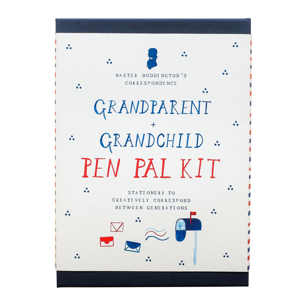 "navy blue boxed stationery kit with white band with the words ""grandparent + grandchild pen pal kit"" in blue and red with illustrated mailbox and letters"