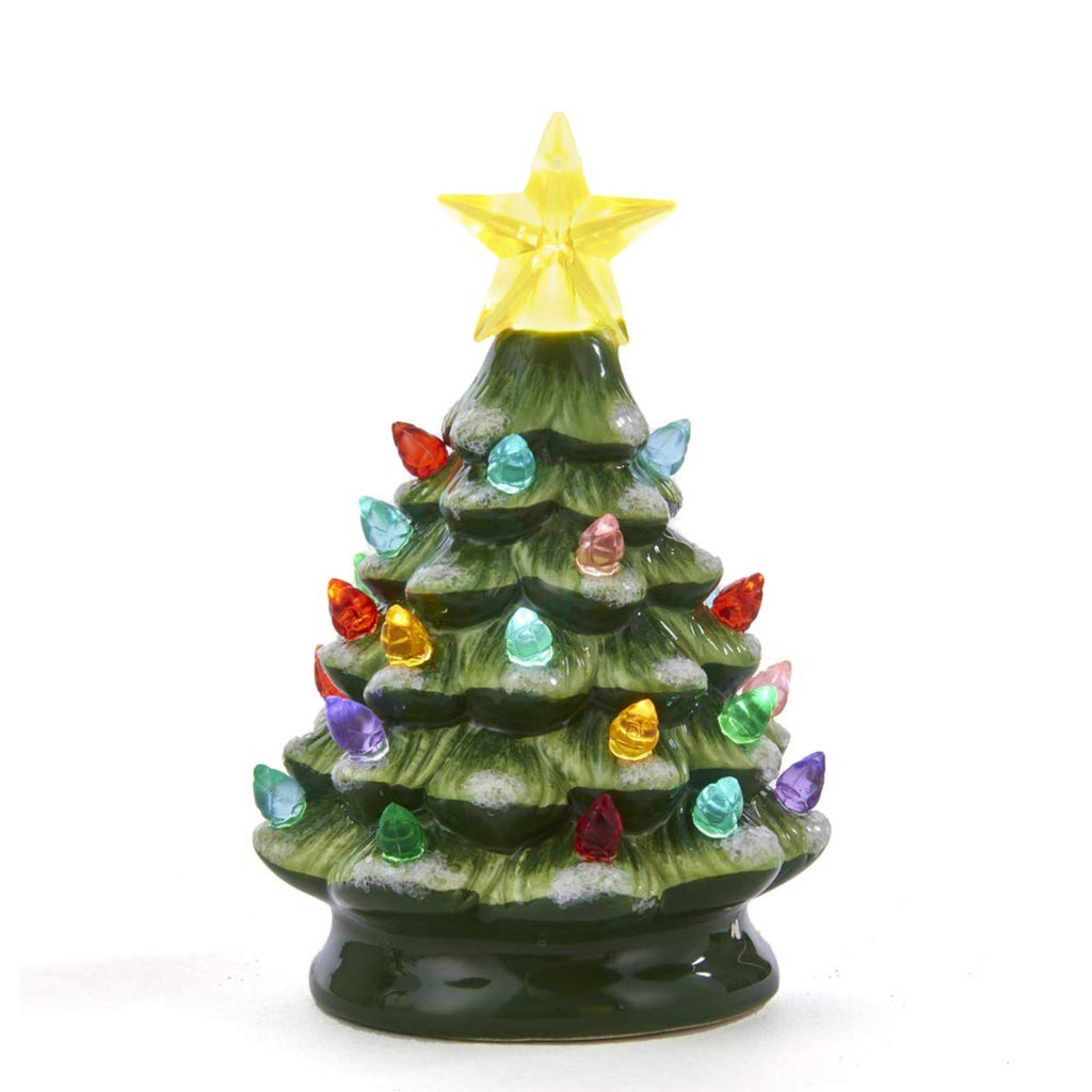 green ceramic christmas tree with multicolored likes and yellow star topper
