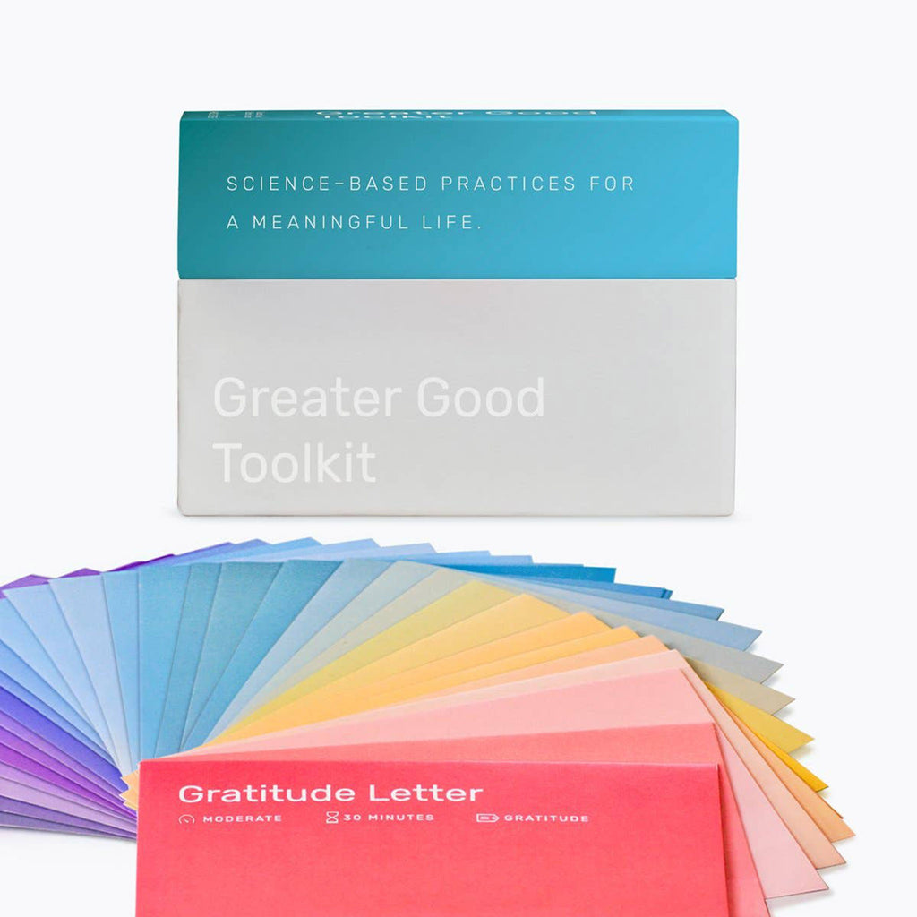 holstee greater good toolkit box with rainbow color cards fanned out in front