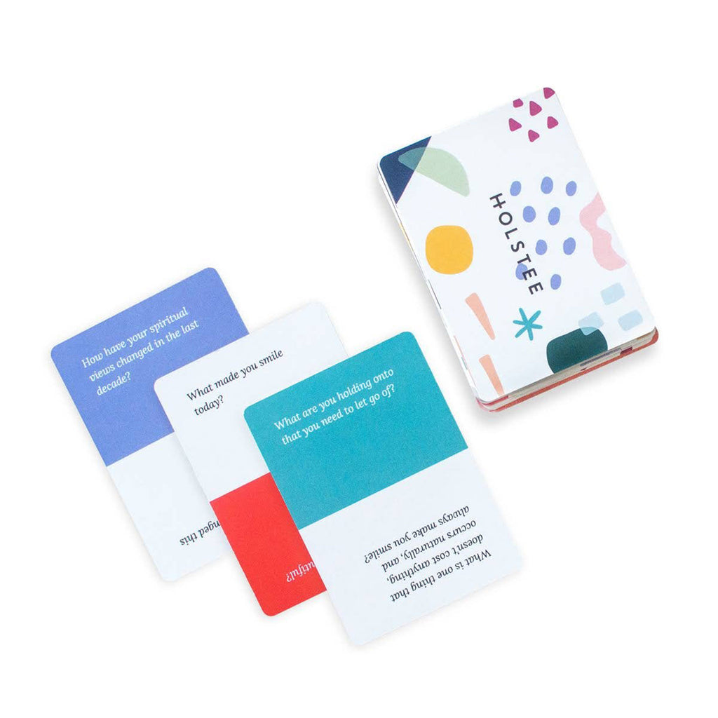 holstee deck of reflection cards with sample question cards