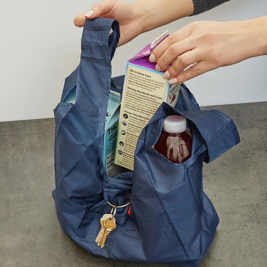 kikkerland blue keychain shopping bag expanded with groceries