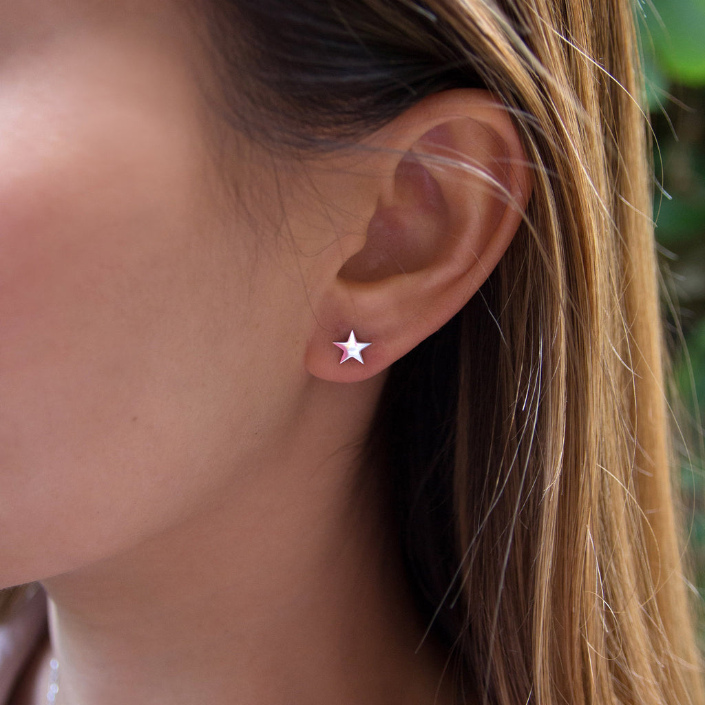 kuku silver star pair of earrings silver plated jewelry stud earring accessory on model