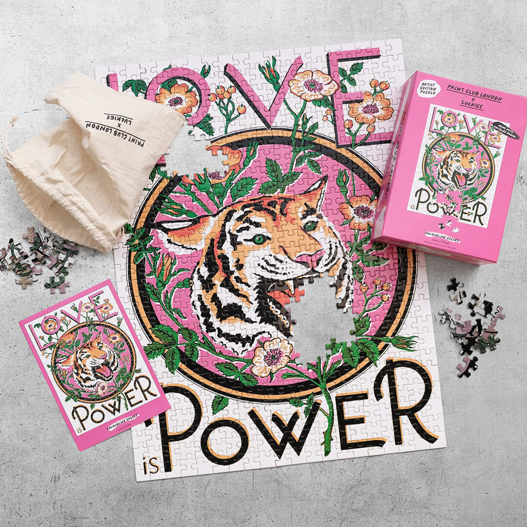 luckies of london x print club london 500 piece love is power family jigsaw puzzle with packaging and puzzle in progress