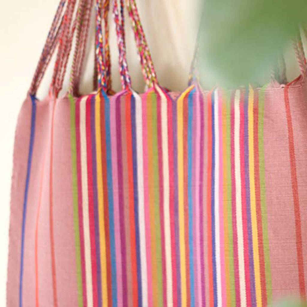 luz collection las rayas hand woven cotton tote bag in palo de rosa with rainbow stripes detail
