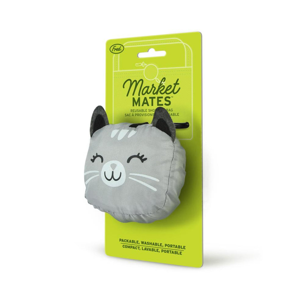 reusable shopping bag folded into a pouch in the shape of a grey cat's head, on a green card